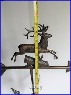 Decade old Decorative John Deere Design Weather Vane on a weighted metal stand