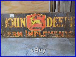 Vintage John Deere advertising sign